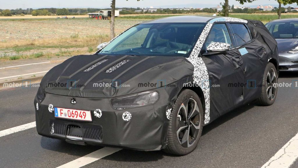 Mystery Kia EV Spotted Testing Alongside Tesla Model 3